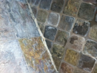 Grout lines/white and rust deposits